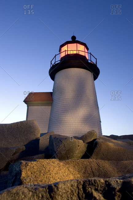 Low angle view of Brandt Point Lighthouse illuminated at dusk