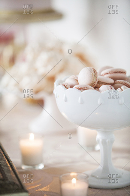 Bowl of macaroons on dessert table at wedding