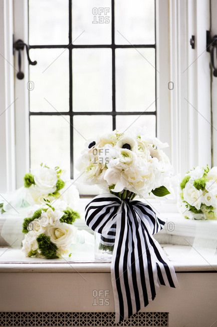 Close-up of bridal bouquets with stripped ribbon