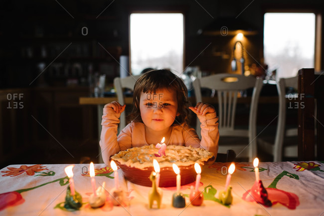 Girl with birthday pie and candles