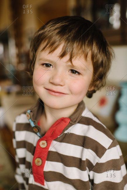 Portrait of young boy in polo t-shirt