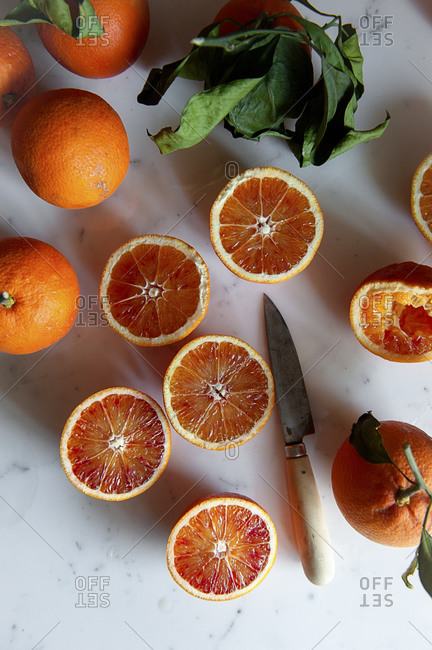 Sliced blood oranges on a tabletop