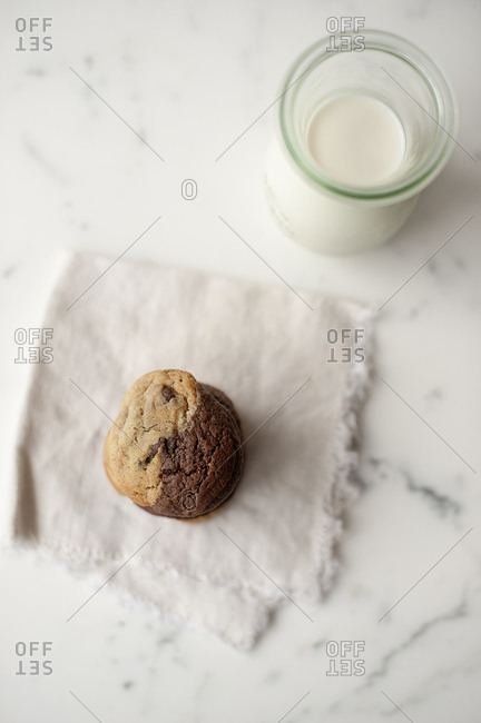 Cookies with a bottle of milk served a tabletop