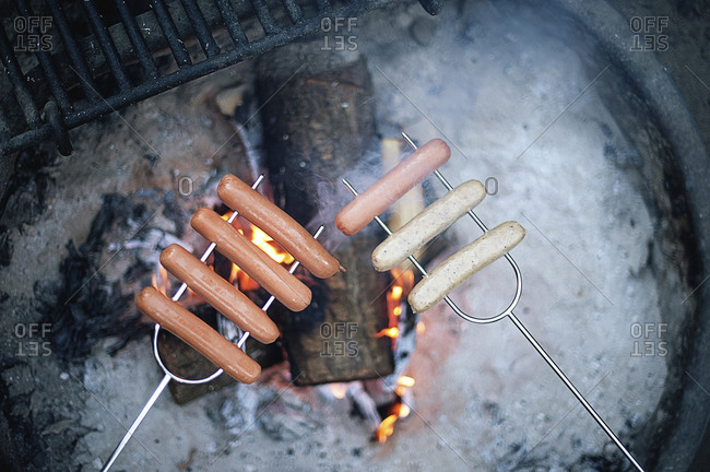 Sausages above a campfire