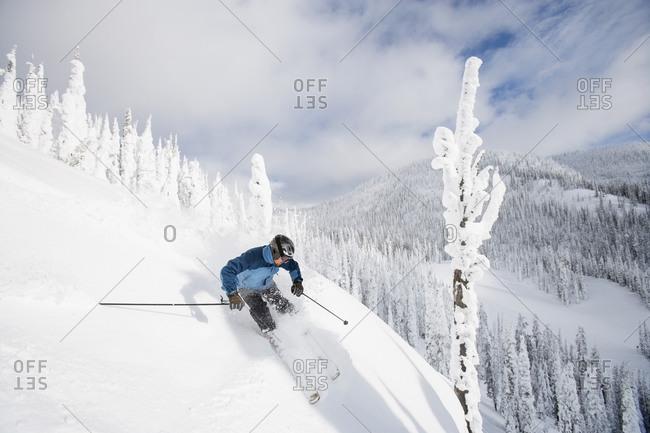 Man skiing in Whitefish, Montana, USA