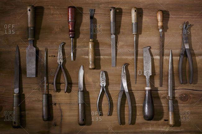 Silversmithing tools on a wooden workbench