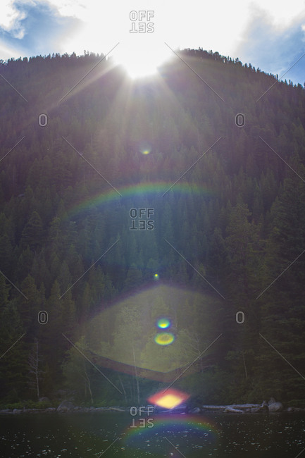 Light rays over a forested mountain in Montana