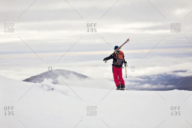 A backcountry skier takes in the view from Burnt Mountain, Maine