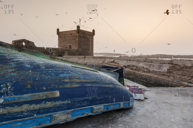 Boat in front of the old city (La Medina) of Essouira from the harbor