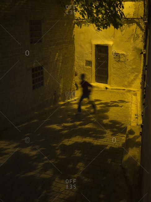 Man walking on street in Fez, Morocco