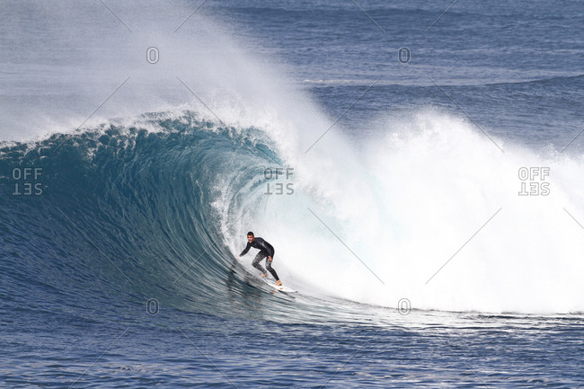 Surfer riding a big hollow perfect wave Fuerteventura, Canary Islands