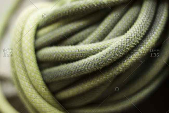 A close up of a coiled climbing rope