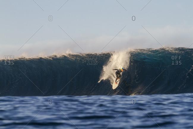 Surfer on a barrel wave called El Quemao in Lanzarote, Canary Islands, Spain