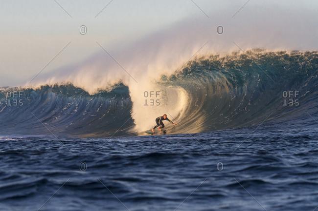 Surfer on a barreling wave called El Quemao in Lanzarote, Canary Islands, Spain