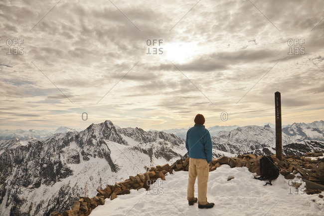 A hiker stands on the summit of Frosty Peak in Manning Provincial Park, British Columbia, Canada