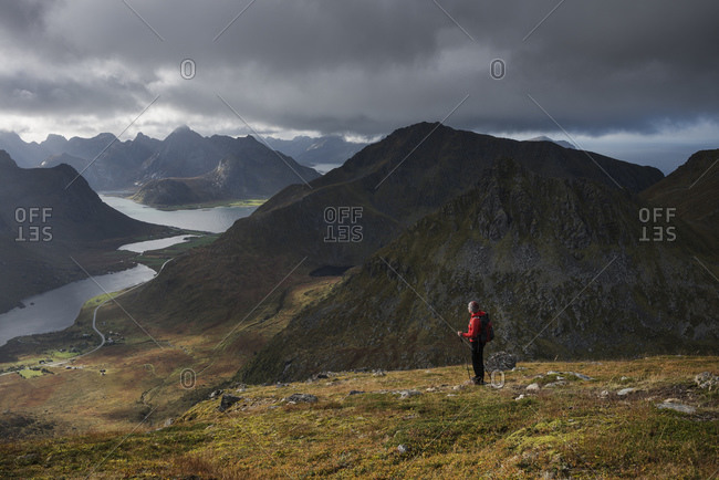 Female hiker on trail towards summit of Stornappstind, Flakstadøy, Lofoten Islands, Norway