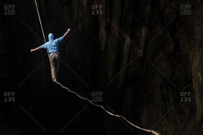 Man walks along a slackline