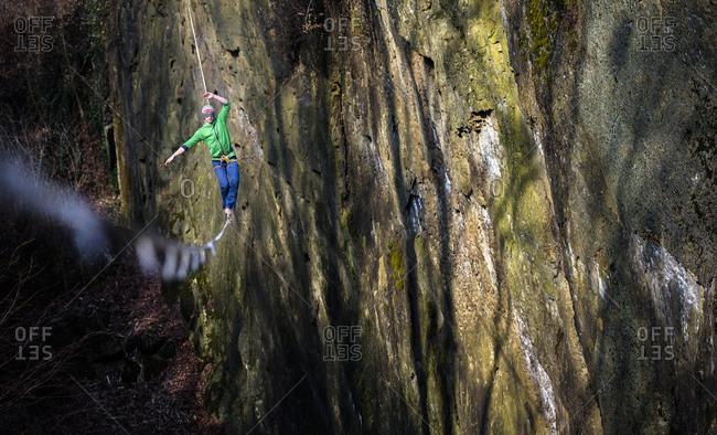 Slackliner walks along a highline