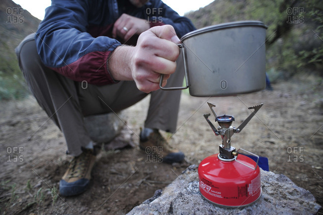 Backpackers prepare dinner with a camp stove by Charleboise Springs in La Barge Canyon on the Dutchmans Trail in the Superstition Wilderness Area, Tonto National Forest