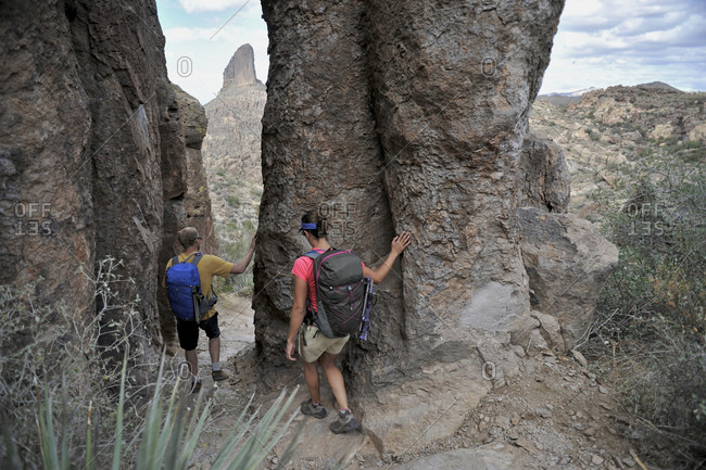 Backpackers explore the rock formations at Fremont Saddle on the popular Peralta Trail in the Superstition Wilderness Area, Tonto National Forest