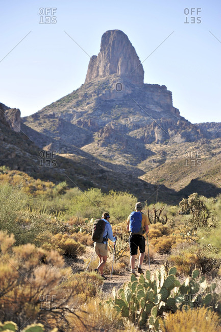 Backpackers hike on the popular Peralta Trail in the Superstition Wilderness Area, Tonto National Forest
