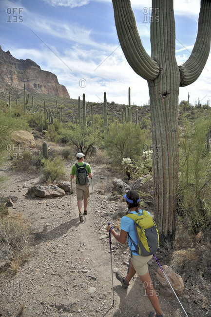 Active couple hikes around Picketpost Mountain in the Tonto National Forest