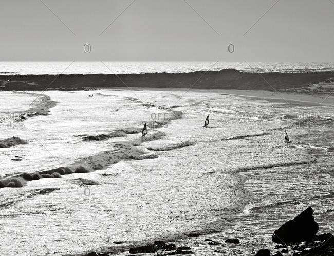 Wind surfers enjoy the waves near Cape Town, South Africa