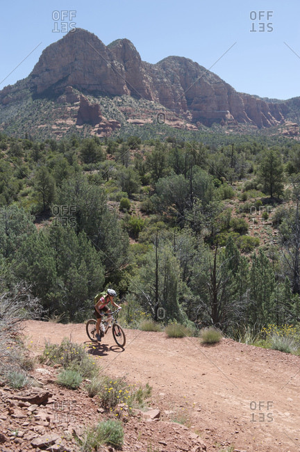 Woman rides the Bell Rock Pathway near Courthouse Butte