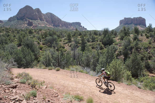 Woman rides through the Bell Rock Pathway near Courthouse Butte