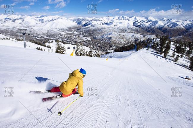 A woman skiing fresh groomers