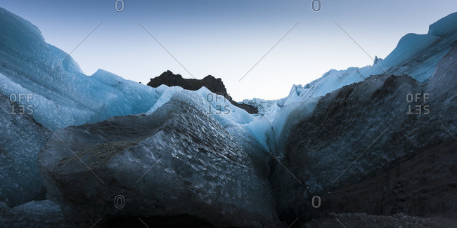 View of surrounding ice cliffs at the glacier Gigjokull South Iceland
