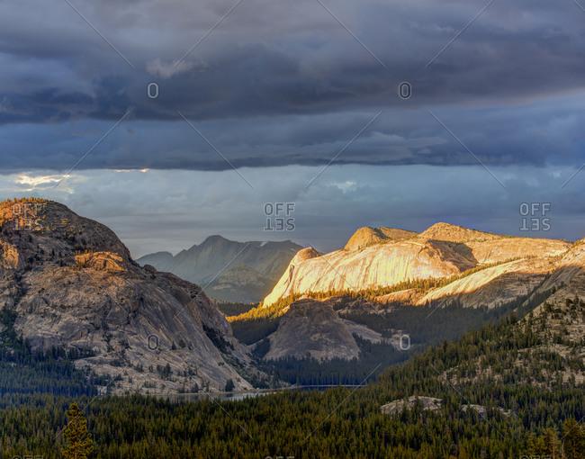 Stormy sunet light over Tenaya Lake along Tioga Pass road, Yosemite National Park