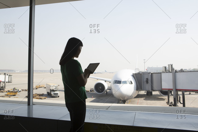 Young woman using a tablet at an airport