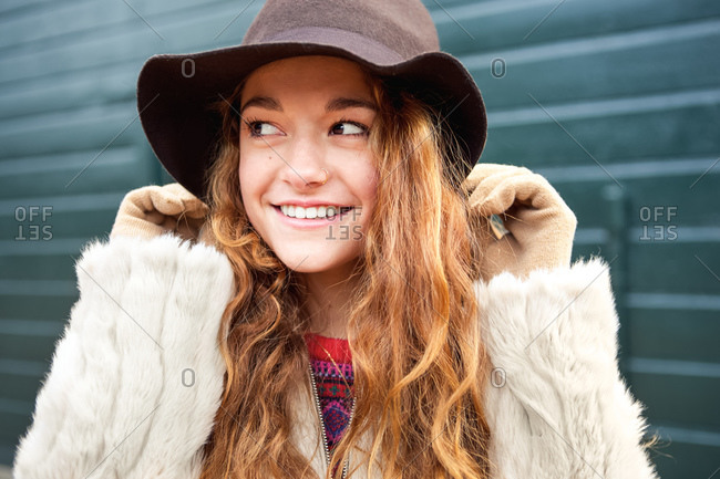 A young girl in a floppy brimmed hat