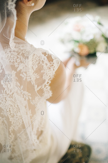 Detail of a bride in her wedding dress