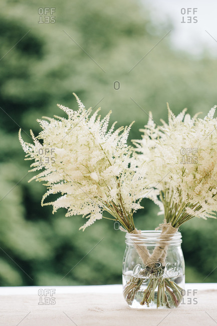 Small wedding bouquets in a mason jar