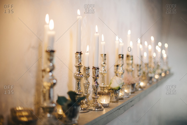 Candles on a shelf at a wedding