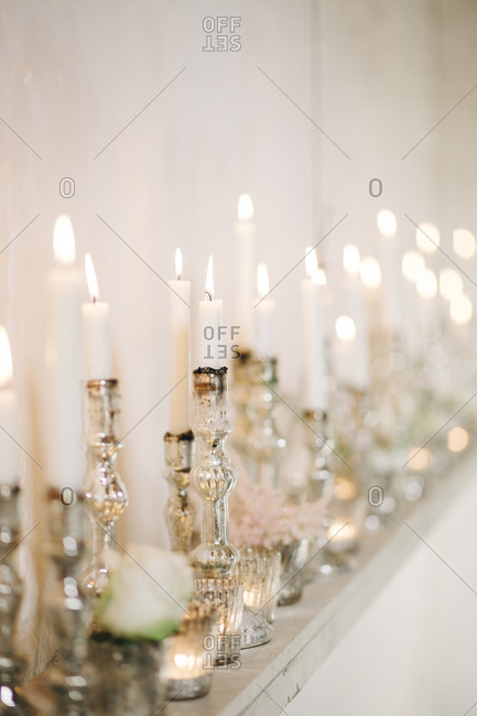 Numerous candles at a wedding