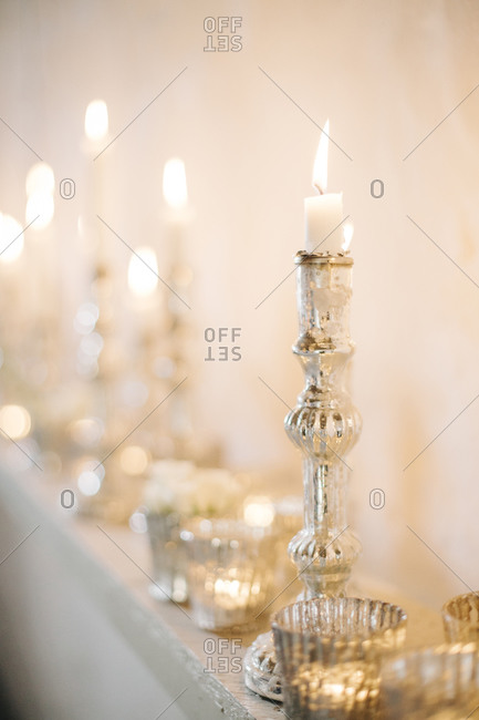 Still life of candles at a wedding