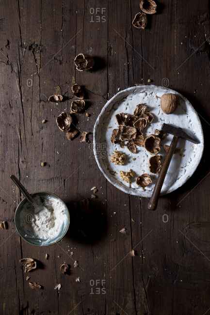 Cracked walnuts and walnut yogurt on a rustic table