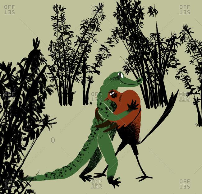 Crocodile dancing with a bird