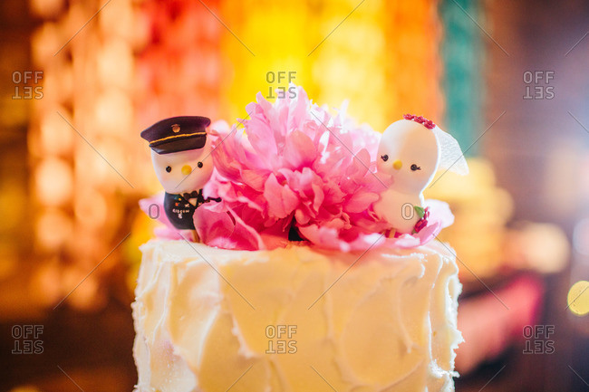 Close up of wedding cake toppers