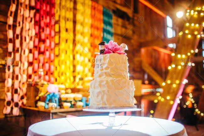 Wedding cake in decorated barn