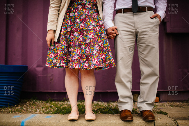 Couple standing side by side from waist down