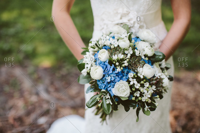 Bride holding her bouquet outside