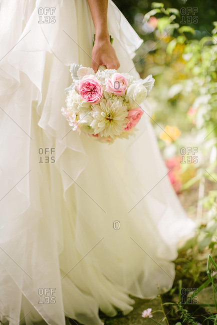 Bride's bouquet and bridal gown skirt