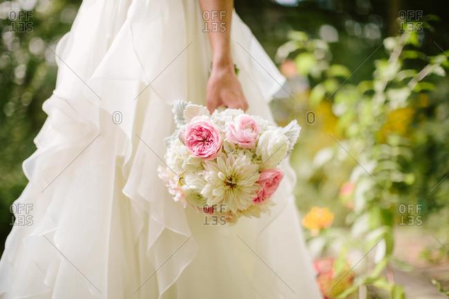Bride's bouquet and wedding dress skirt