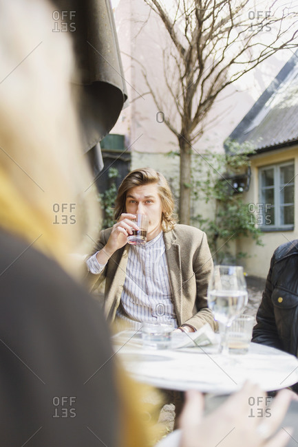 Young man drinking in a cafe