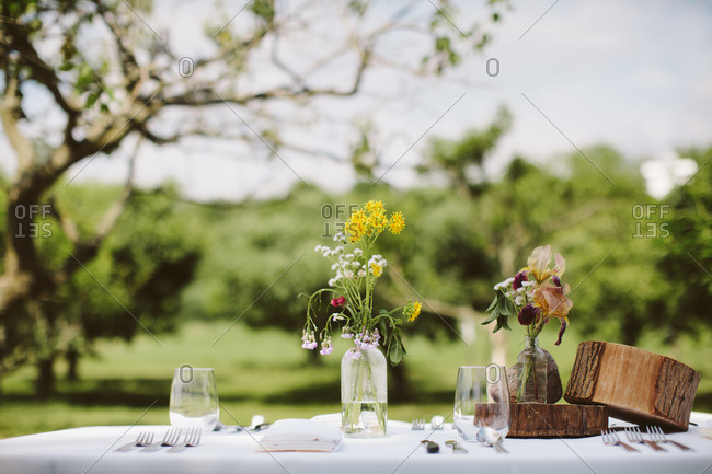 Table set with wildflowers in vases