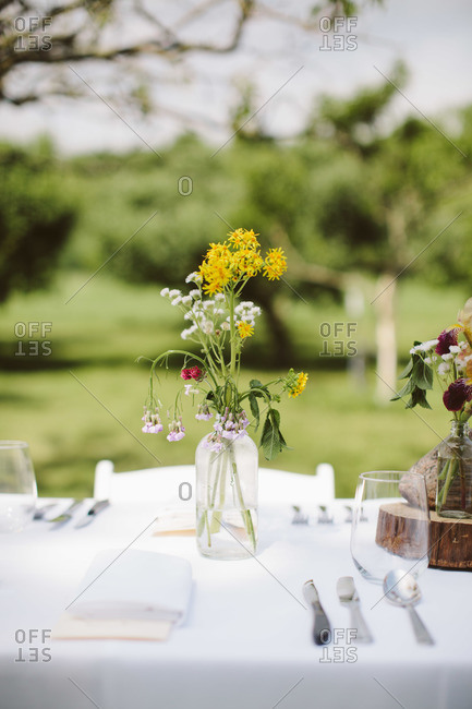 Wildflower vases on outdoor table